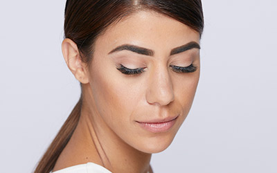 Model demonstrates the look of Amazing Volume Glam (6D) lash extensions with eyes closed