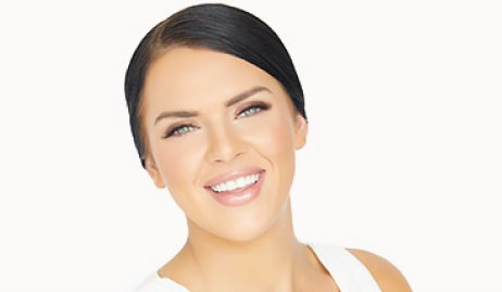 Woman Smiling with Full Eye Lashes