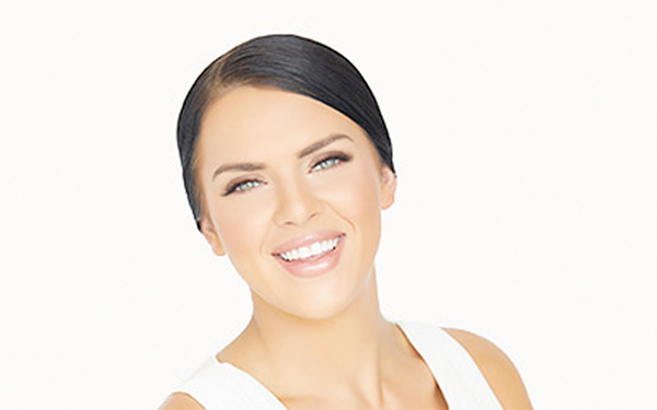 Model with lashes and hair pulled back
