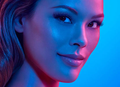Paula with Lash Extensions under blue gel lights